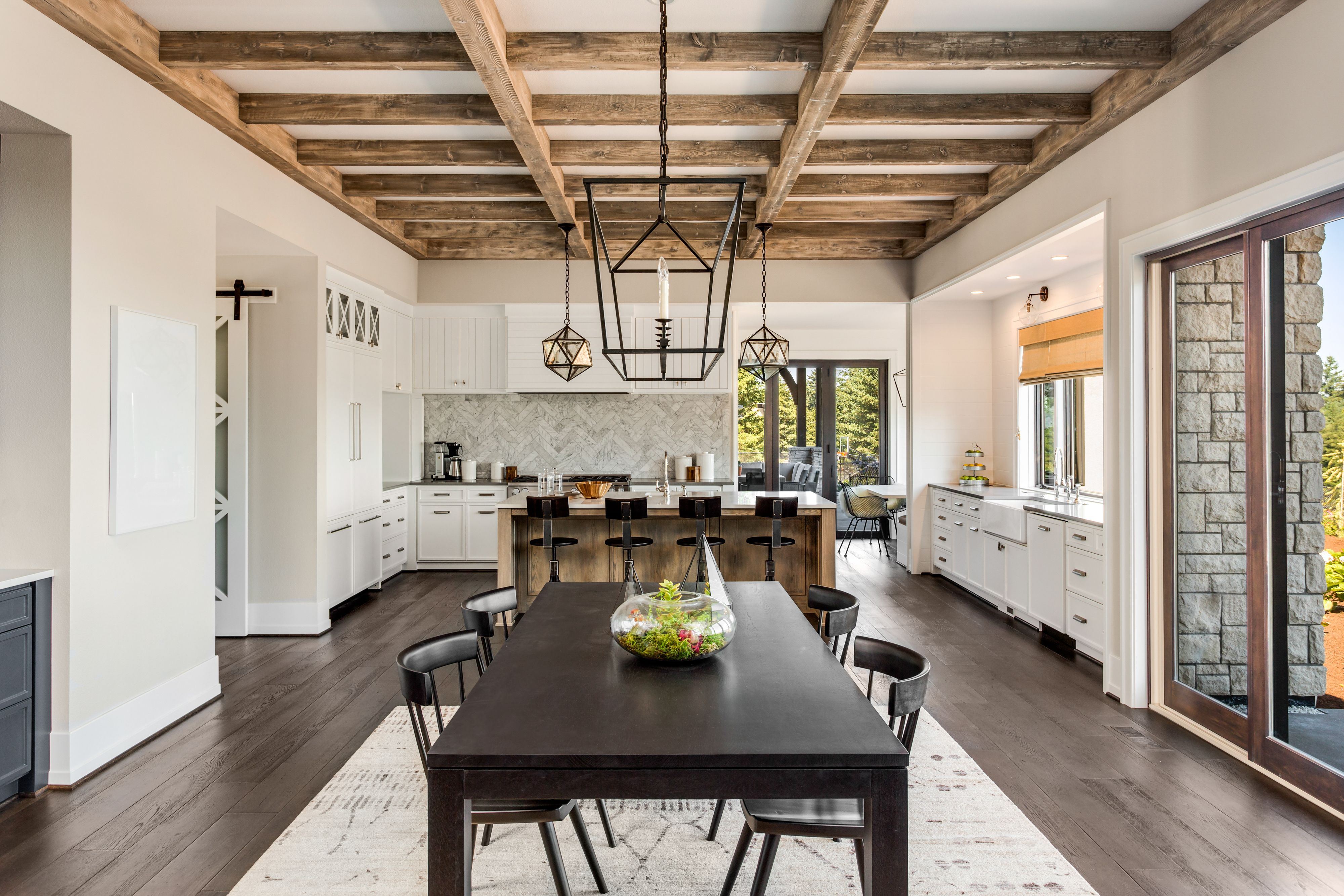 Canva   Stunning Kitchen And Dining Room In New Luxury Home Wood Beams And Elegant Pendant Lights Accent This Beautiful Open Plan Dining Room And Kitchen